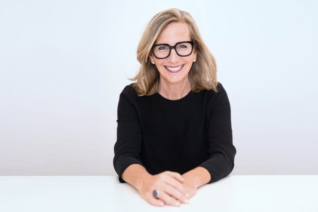 A photo of SheEO founder Vicki Saunders smiling directly into the camera.