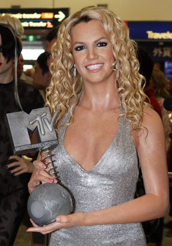 A photo of Britany Spears, smiling into the camera, holding a MTV Award